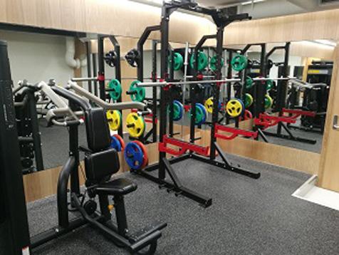 Eiendomshuset Malling treningsrom med half rack