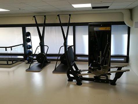 Eiendomshuset Malling treningsrom med stakemaskiner